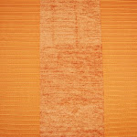 Welurowa tkanina obiciowa w pasy. Pomarańczowa.