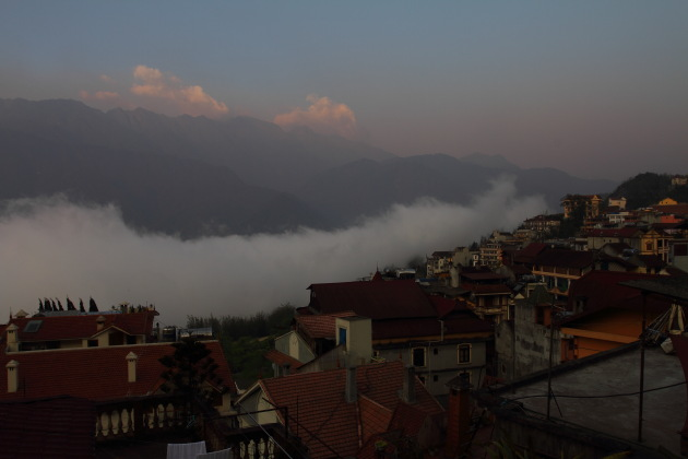 Sunrise over the clouds, mountains and Sapa town of Vietnam