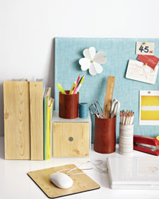Bring a natural note to Mom's home office with coordinated wood-grain accessories. All it takes to make a matched set of mouse pads, file boxes, and straight-sided glass jars is self-adhesive shelf liner. (marthastewart.com)