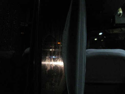 Our view for hours into the blackness outside as a huge line of buses stopped on the cliff.