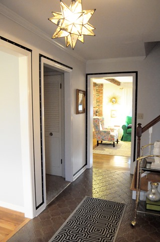 grosgrain ribbon and upholstery tacks around doorways