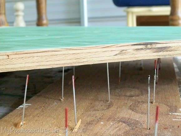 using nails to suspend board for painting
