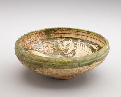 Bowl | Origin:  Iran | Period: 12th-13th century | Details:  Not Available | Type: Earthenware with decoration carved through a white slip and coloring under a transparent glaze | Size: H: 7.4  W: 19.6  cm | Museum Code: F1925.10 | Photograph and description taken from Freer and the Sackler (Smithsonian) Museums.