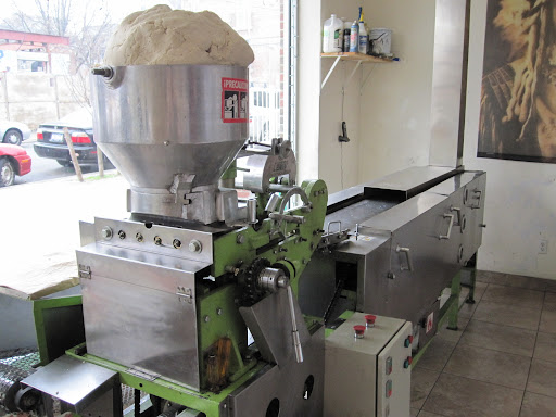 Masa loaded into the machine that will make tortillas
