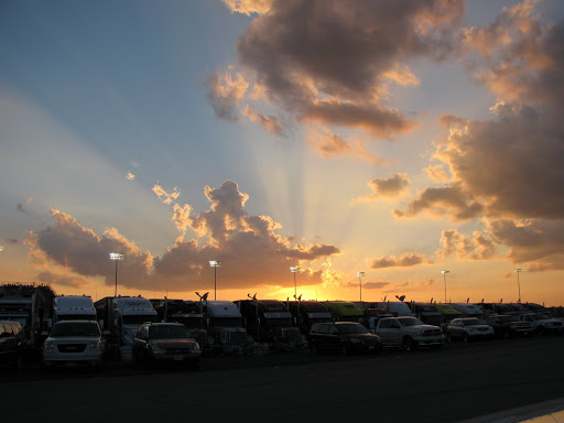 The sun sets over the haulers at Gateway Raceway.