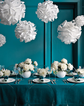 For a twist on the fancy chandelier, hang these fluffy pom-poms instead. (marthastewartweddings.com)
