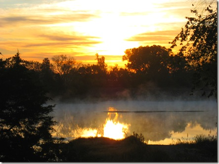 Kansas Sunrise, steam on lake, orange and gold sunrise,