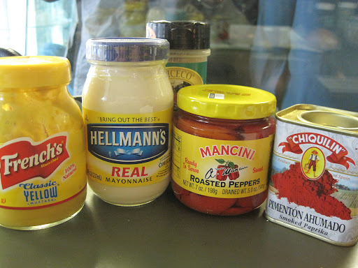 Mustard, mayo, roasted peppers, and smoked paprika - part of the line-up for pimiento cheese.