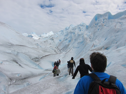 Walking in a line flanked by guides.