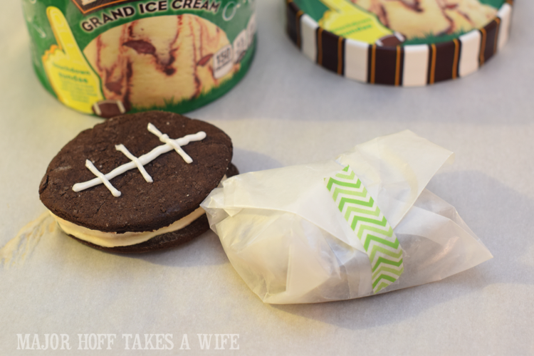 Wrap an ice cream sandwich for storage. Looking for a fun party for your teenage boy? Why not throw a Football video game party? Easy ideas for how to entertain kiddos during the Big Game. Features DiGiorno pizza, personalized football cups, free printable lanyards, and an incredible recipe for football shaped ice cream sandwiches! #GameTimeMVP #CollectiveBias #ad