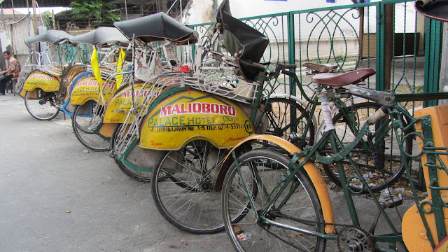 "Bicycle taxis called ""becaks"", like these outside our hotel, are popular throughout Indonesia."