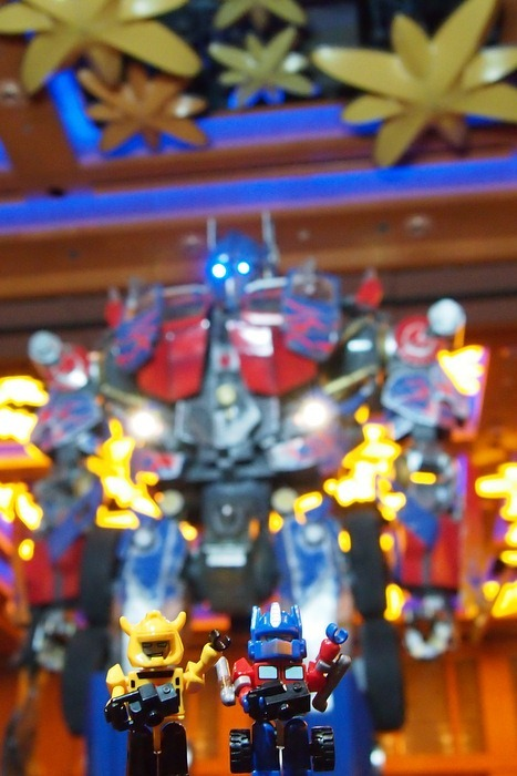 Optimus Prime and Bumblebee in front of 22-foot Movie Optimus Prime