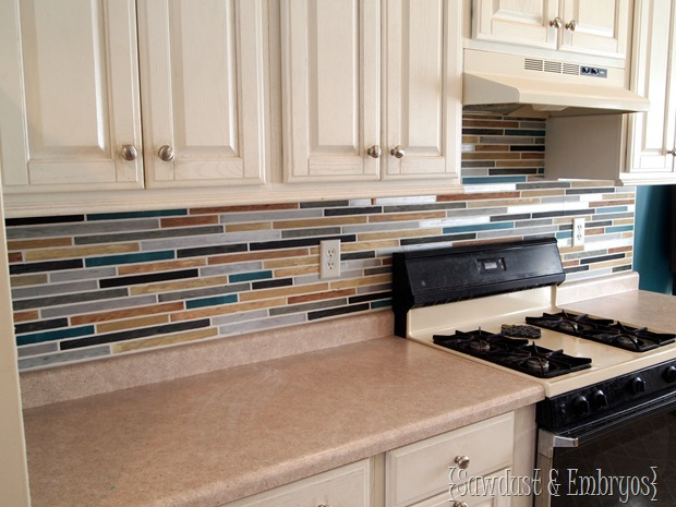 Metallic paint adds a glamorous shimmer to this painted backsplash.