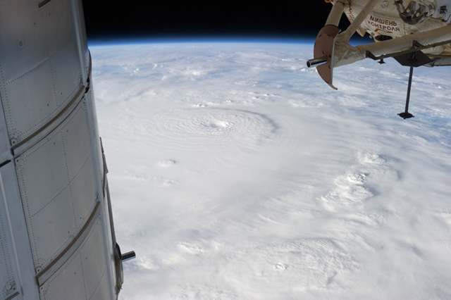 Typhoon Bopha is shown moving toward the Philippines from the International Space Station, 2 December 2012. The typhoon slammed into the Davao region of the Philippines early on 4 Decemer 2012, killing hundreds and forcing more than 50,000 to flee from inundated villages. NASA / Associated Press