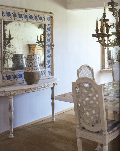 The Fremontier's dining area has a table and mirror incorporating eighteenth-century Spanish tiles, designed by the homeowner.  (Dealer's Choice, Architecture/Interiors Press, Inc.)