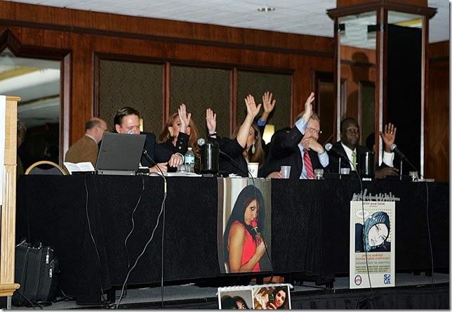 Raise Hands Death Threats- Left to right, Robert Muise, Pamela Geller, Nonie Darwish, Robert Spencer, James Lafferty, Simon Deng, Darwin Jiles - sm