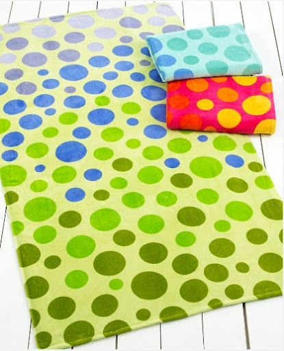 An oversize, really plush towel is key for long hours on the beach. Martha Stewart Collection Beach Towels  (macys.com)