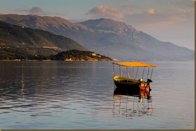 Boat floating on Lake Ohrid at dusk