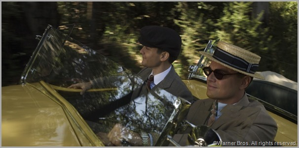 Nick Carraway (Tobey Maguire, L) and Jay Gatsby (Leonardo DiCaprio) out for a wild spin. CLICK to visit the official site for THE GREAT GATSBY movie.