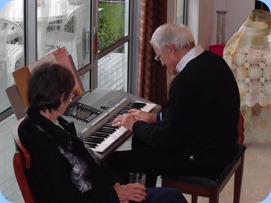 John Stent playing the PSR-910 with Secretary, Colleen Kerr, watching on with keen interest.
