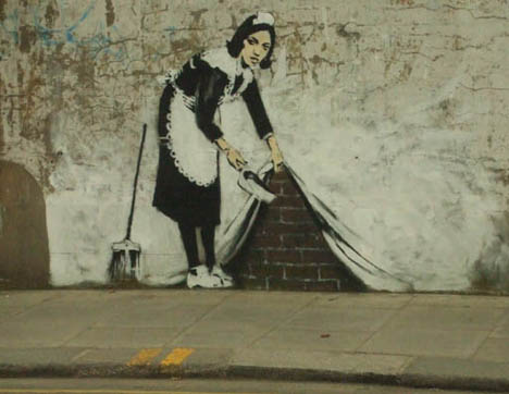 guerrilla-art-banksy-maid-sweep.jpg