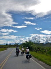New friends riding towards El Bordo, Colombia under an unreal sky.