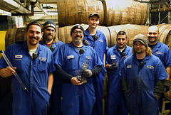 image of Full Sail Brewers standing near the barrels, courtesy the brewery