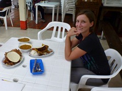 Jenn sampling her first Bandeja Paisa with new friends outside Medellin.
