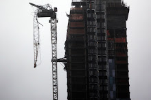 NEW YORK, NY - OCTOBER 29: Part of a crane boom is seen hanging off a building under construction on West 57th Street