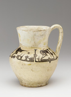 Jug | Origin:  Nishapur,  Iran | Period: ca. 900-1000 | Details:  Not Available | Type: Ceramic Wheel-thrown with applied handle, glazed, and fired | Size: H: 23.2  W: 21.1  cm | Museum Code: S1987.96 | Photograph and description taken from Freer and the Sackler (Smithsonian) Museums.