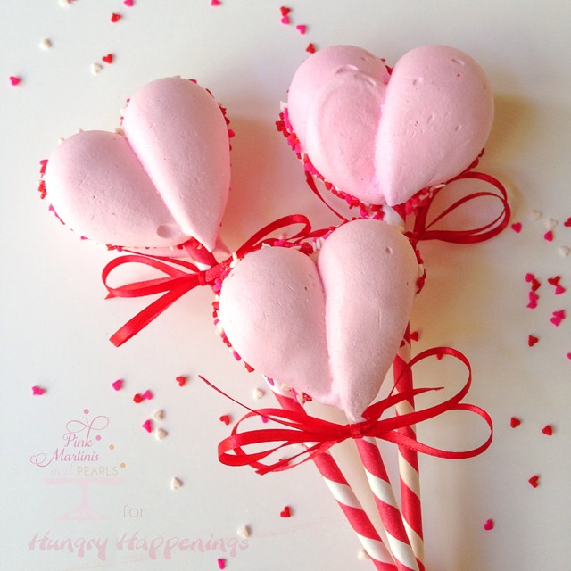 Chocolate might reign supreme as the sweet choice for Valentine's Day but if something lighter tickles your fancy, then these Meringue Heart Cookie Pops just might make your heart go all aflutter.