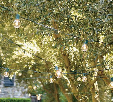The right lighting adds a special and festive touch to an outdoor space. Strung from trees around the backyard or over the bar, these hanging lights remind me of old-time italian cafes.  (potterybarn.com)