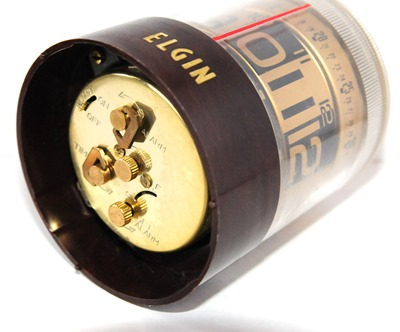 Elgin cylindrical tube rotating wind-up alarm clock