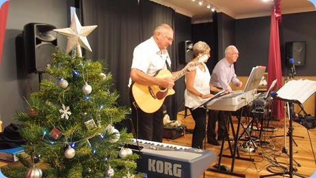 And the Band played on! Kevin and Jan Johnston with Peter Brophy swinging along. Photo courtesy of Dennis Lyons.