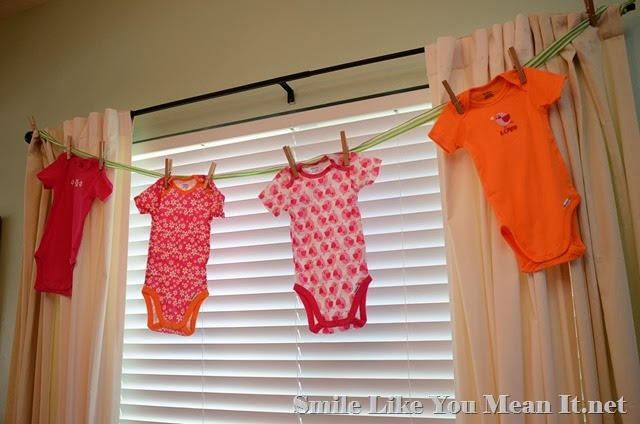 Pink and Orange Onesies on a clothesline