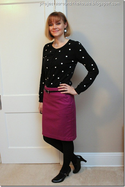 black polka dot sweater, pink skirt