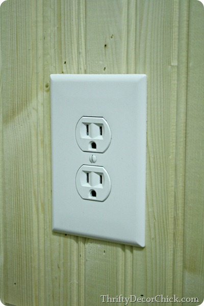 Adding spacers to outlet to make it flush with wall