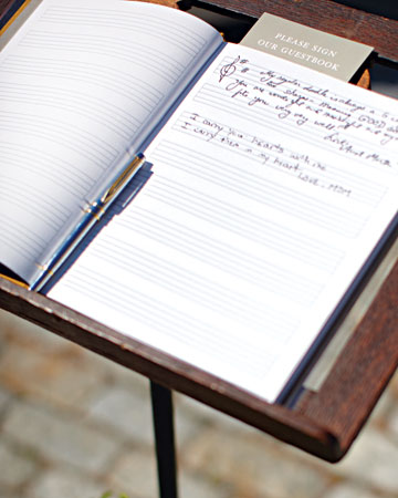 A guest book of sheet music perched on an antique music stand is a nod to the grooms' careers.