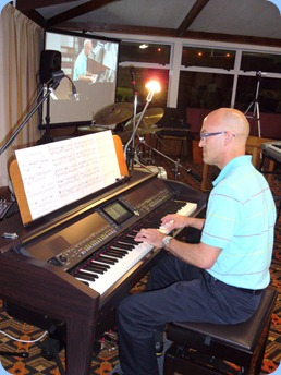 "Warren Levick played some straight piano and then some style arrangements on the Clavinova. Very nice too - especially Warren's rendition of Elton John's ""Blue Eyes""."