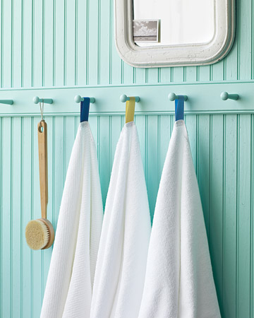 Your family and guests won't confuse their white towels if you color-code them with hanging loops.