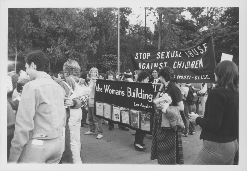 Women from the Woman's Building holds up their banner at the Women Take Back the Night march. April 19, 1980.
