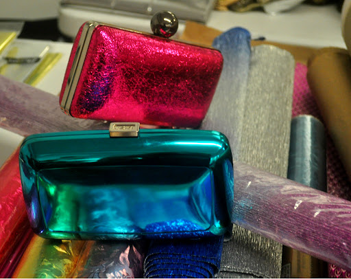 Cool compacts. The pink is from Milly (millyny.com)  and the blue is Roger Vivier (www.rogervivier.com).