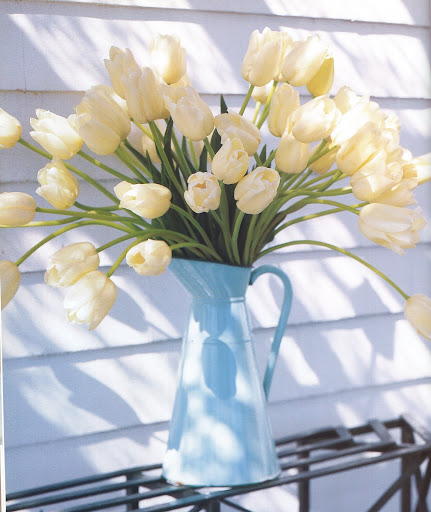 Clean white tulips spill from an agateware wash pitcher. (The Best of Martha Stewart Living -- Arranging Flowers)