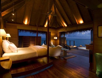Deluxe Water Villas feature a view over the Indian Ocean.