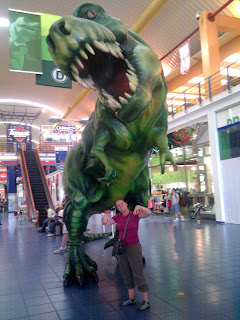 Heather poses with T-rex at the Albrook Mall, Panama City, Panama