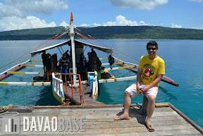 Hubby sitting at the boat dock while waiting for the Scubasurero divers to arrive