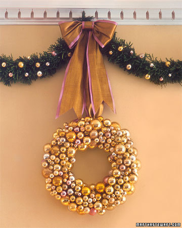This full-bodied everlasting wreath is crafted from bundles of gold, pink, and silver glass balls on wire stems.