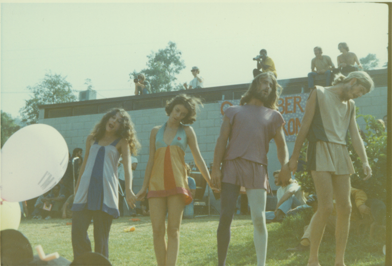 Four people in costume at the Gay-In at Griffith Park, Los Angeles. 1970.