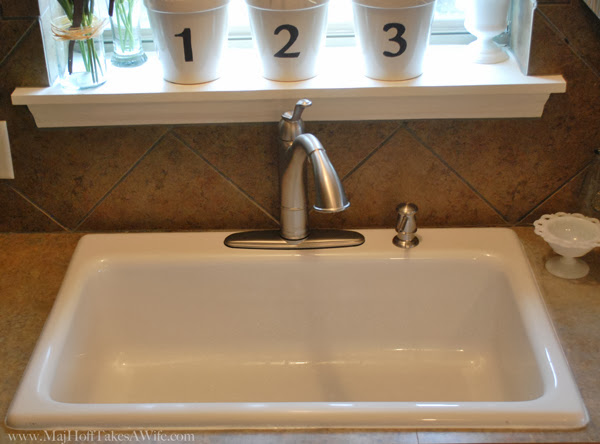 White fiberglass sink basin