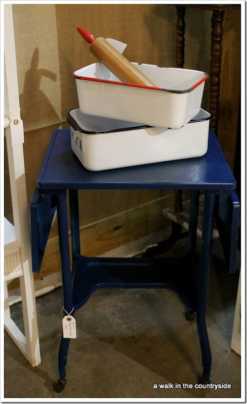 antique booth with vintage typewriter table and enamel refrigerator bins